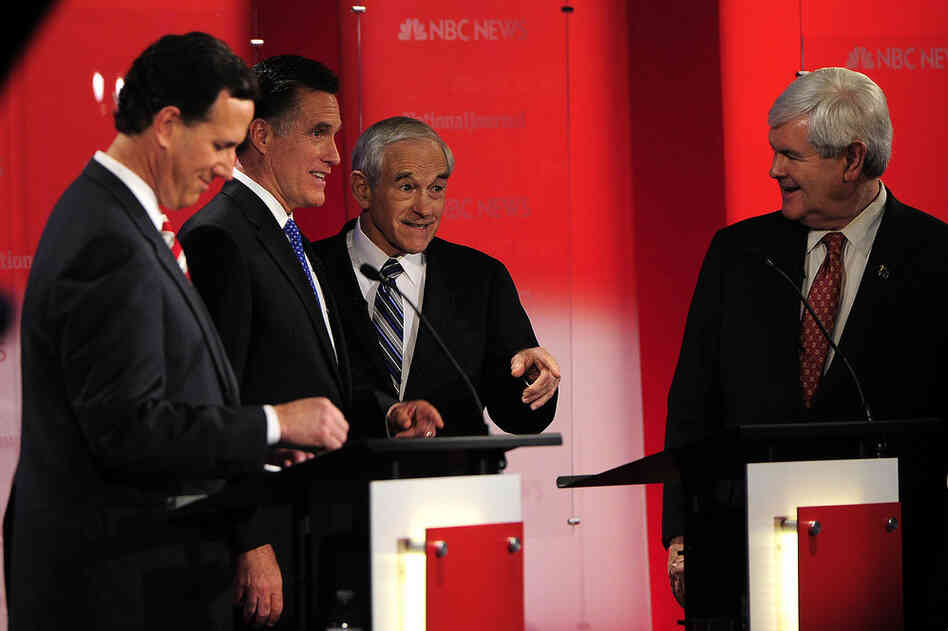 The Republican presidential candidates chat after the debate's end.