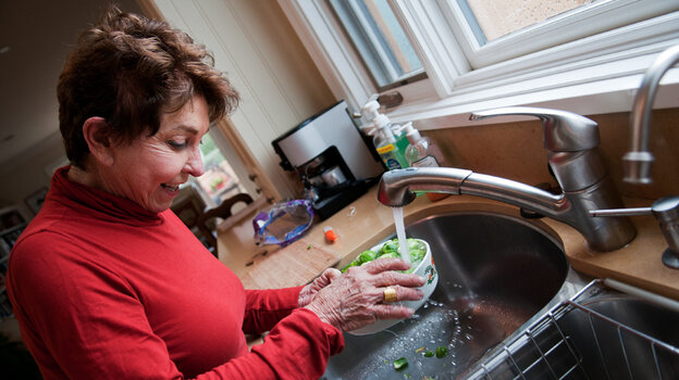 Sue Freeman, 78, washes Brussels sprouts at her home in Laguna Beach, Calif., on Saturday. Prior to getting an experimental stem-cell procedure last July, Freeman couldn't cook, read or recognize faces.