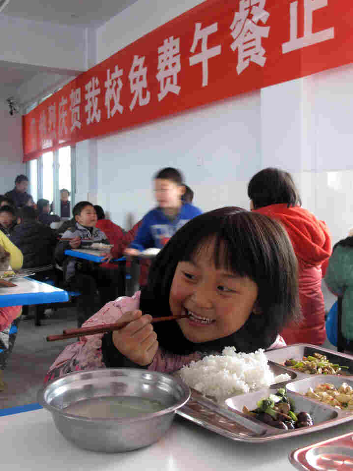 Students enjoy free meals on the inaugural day of the Free Lunch for Children program at Hujiaying primary school in Shaanxi province's Nanzheng county.