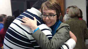 Rep. Gabrielle Giffords hugs Daniel Hernandez, the former intern who helped save her life.