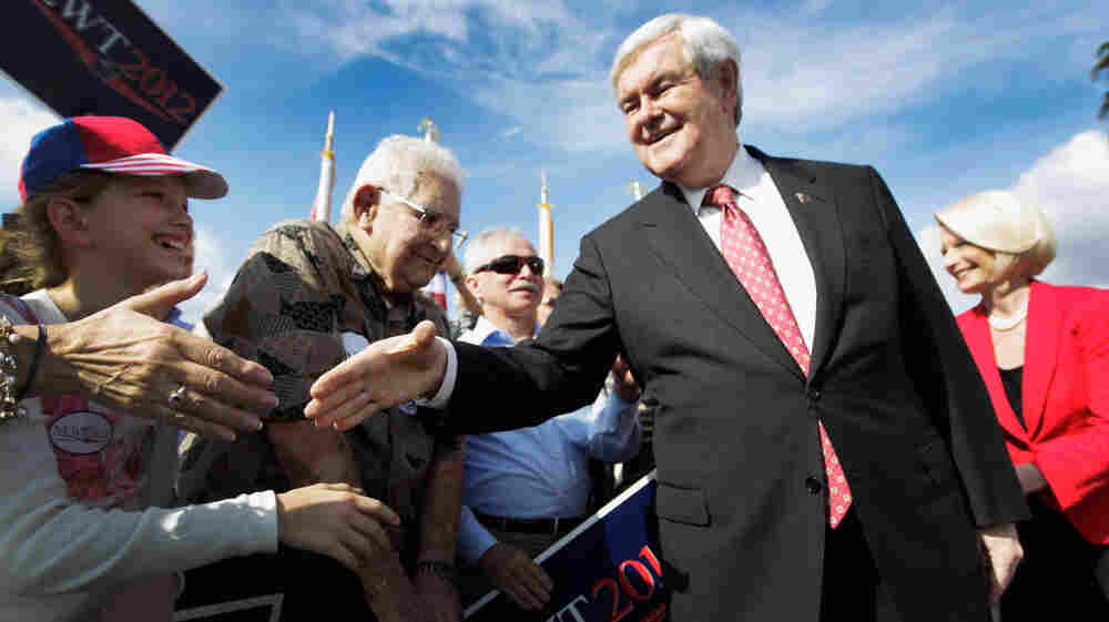 Republican presidential candidate Newt Gingrich and his wife Callista Gingrich (in red) greet people during an event at the The River Church in Tampa, Fla., earlier today (Jan. 23, 2011).