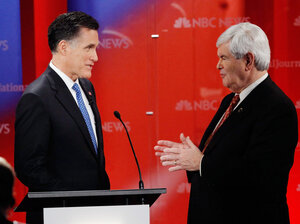 Republican presidential candidates Mitt Romney and Newt Gingrich talk during a commercial break as they participate at the debate held on Jan. 23, 2012 in Tampa, Florida. Republicans have made vigorous attacks on Romney's time at Bain Capital.
