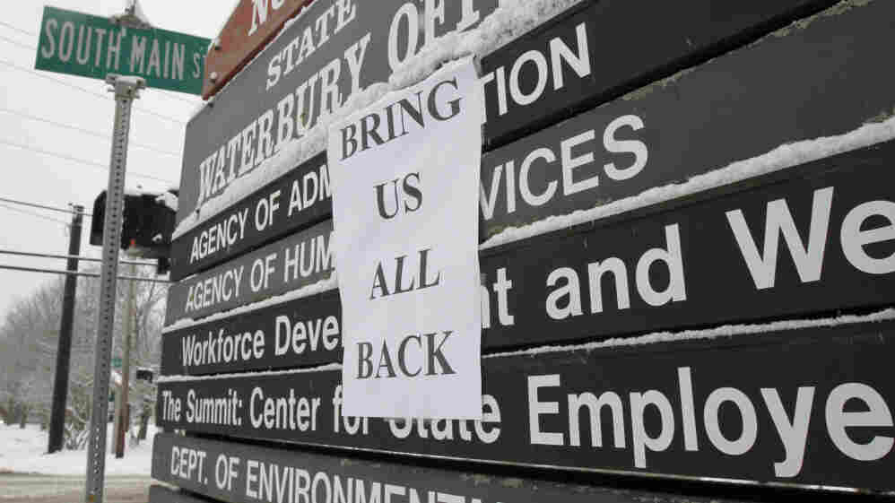 A sign is posted at the entrance to the state office complex on in Waterbury, Vt., About 1,500 people who worked in the complex were relocated due to damage caused by Tropical Storm Irene.