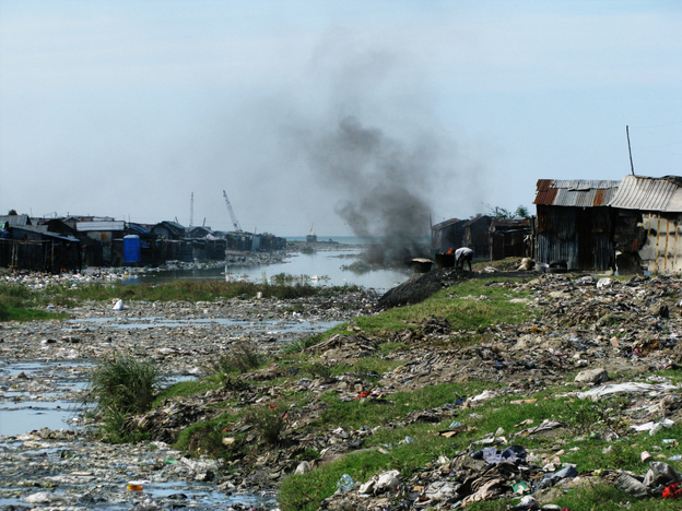 A garbage and sewage filled channel cuts through Cite Soleil, a slum in Port-au-Prince, Haiti. Poor sanitation and lack of access to clean drinking water are the main factors that contribute to the spread of cholera.