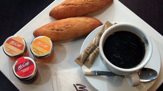 A McDonald's breakfast meal in Villeurbanne, France includes fresh baguettes and jam spreads with coffee for $4.55. (Maxppp /Landov)