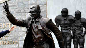After former Penn State coach Joe Paterno's death was announced Sunday, fans paid their respects at a Paterno statue on campus. Paterno exerted a rare amount of control in his decades coaching football, says Frank Deford.