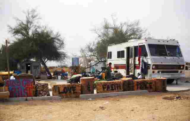 Slab City is an informal community in the California desert on the site of a former WWII artillery range. The recent recession has sent the to