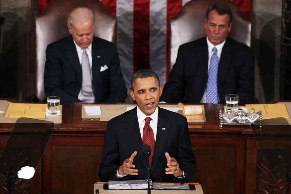 President Obama, flanked by Vice President Biden and Speaker of the House John Boehner, delivers his State of the Union speech Tuesday in Washington.