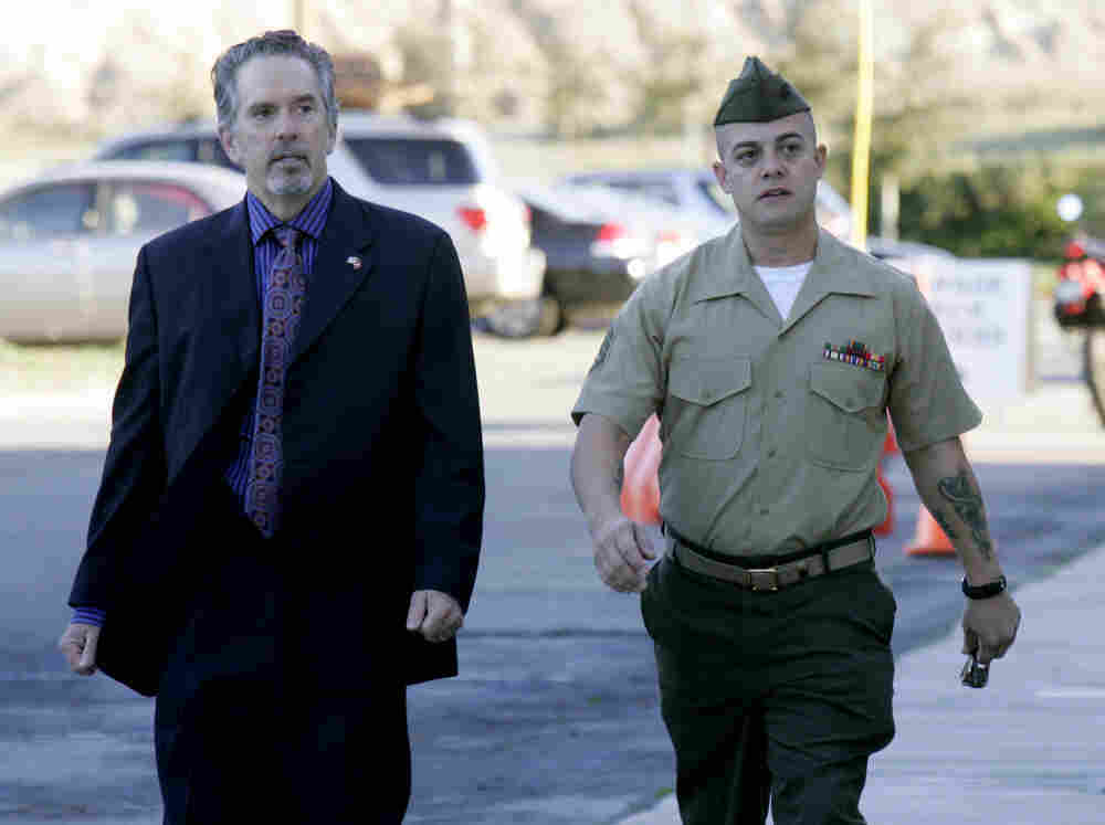 U.S. Marine Corps Staff Sgt. Frank Wuterich (R) walking into court with his defense attorney Neal Puckette for opening statements in the Haditha murders trial at Camp Pendleton on Jan. 9.