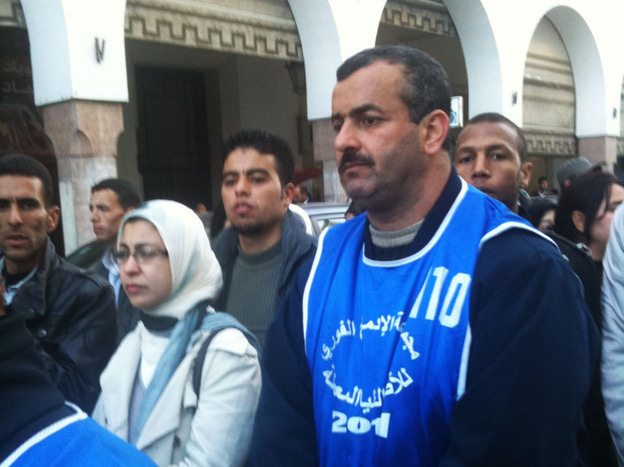 Activists gather to march against youth unemployment in the Moroccan capital of Rabat. Protesters wear colored vests with the slogan of their respective groups.