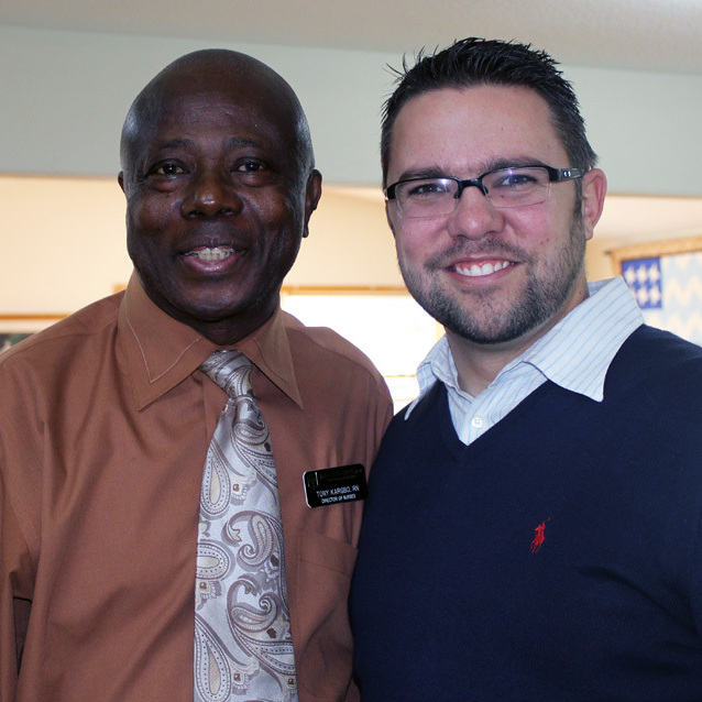 Benjamin Anderson (right), Ashland Health Clinic's CEO, poses with Tony Kargbo (left), who was just hired as the director of nursing for the clinic's long-term care facility.