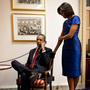 This handout photo provided by the White House shows President Barack Obama, accompanied by first lady Michelle Obama, during a phone call from the Capitol in Washington immediately after his State of the Union Address. The president  informed John Buchanan that his daughter Jessica was rescued by U.S. Special Operations Forces in Somalia.