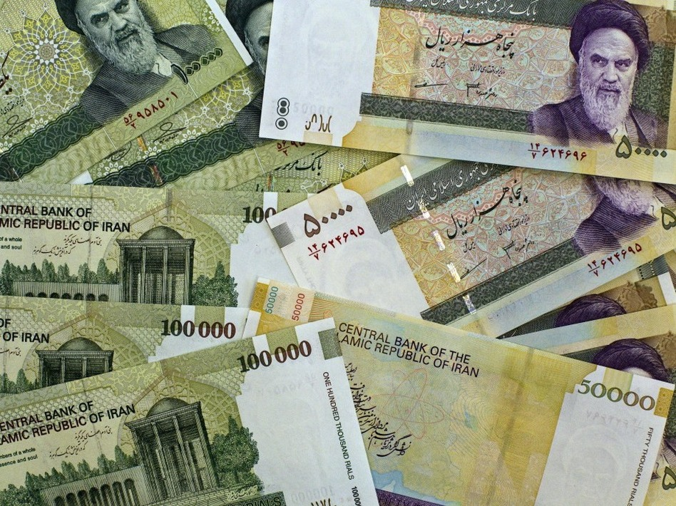 On Jan. 24, the exchange rate plummeted to 23,000 rials to the U.S. dollar. For years, the value of the Iranian currency was artificially maintained. Now, international sanctions and domestic politics are forcing a devaluation. (AFP/Getty Images)