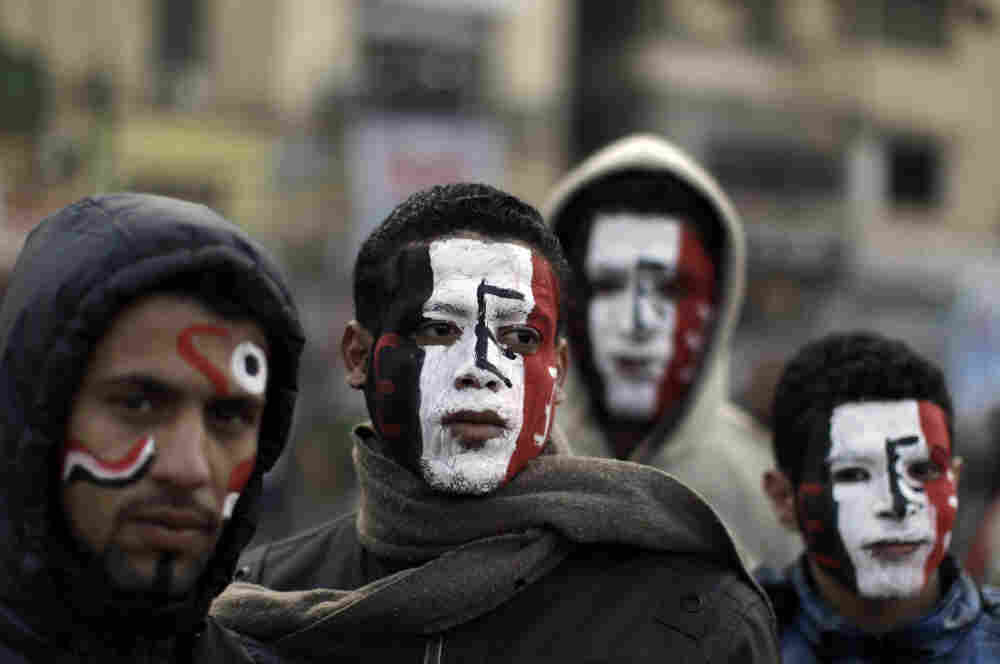 Egyptians wear face paint in the colors of the national flag in Tahrir Square as thousands gather to mark the one year anniversary of the uprising that ousted President Hosni Mubarak in Cairo.