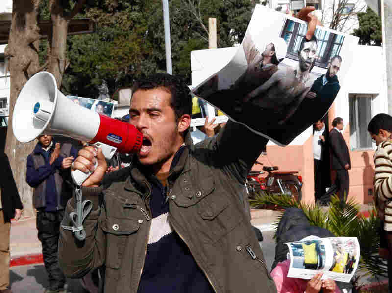 Demonstrators carry posters of Abdelwahab Zaydoun, who set himself on fire and died from his burns Tuesday. Zaydoun was part of a movement protesting unemployment in Morocco.