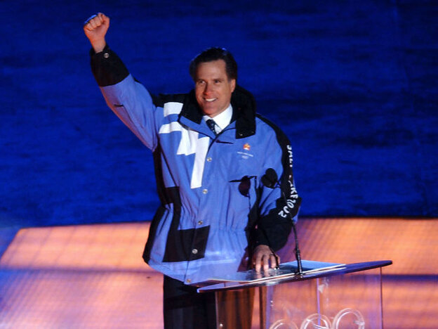 Mitt Romney, then the president of the 2002 Salt Lake Organizing Committee, greets attendees at the opening ceremony of the Winter Olympics in Utah.