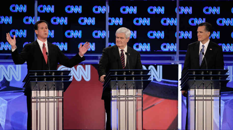 Rick Santorum (from left), Newt Gingrich and Mitt Romney debate Thursday night in Jacksonville, Fla.
