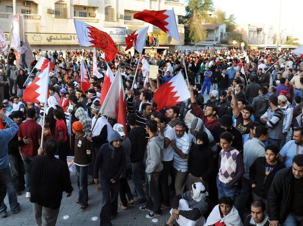 Bahraini protesters wave their national flag in the village of Sanabis near Manama on Feb. 14, 2011.