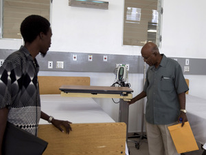Visitors tour the new teaching hospital in Mirebalais on Jan. 10. The hospital will have a CT scan machine — one of only four in the country, and the only one at a public facility.