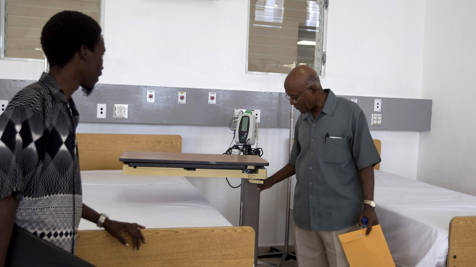 Visitors tour the new teaching hospital in Mirebalais on Jan. 10. The hospital will have a CT scan machine — one of only four in the country, and the only one at a public facility. (AP)