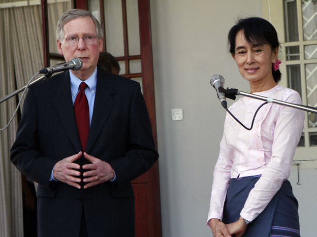 U.S. Senator Mitch McConnell talks as Myanmar pro-democracy leader Aung San Suu Kyi listens during a press conference after their meeting at her home in Yangon, Myanmar on Monday.
