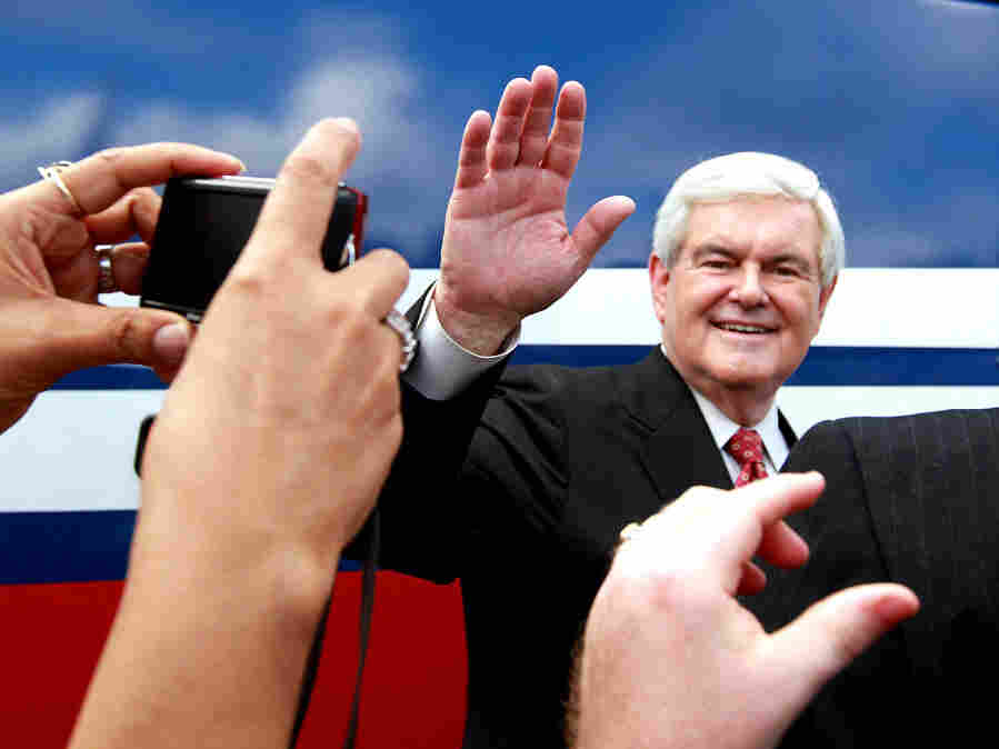 Newt Gingrich greets supporters during a rally at Wings Plus in Coral Springs, Fla., on Jan. 25. The GOP candidates meet in Jacksonville Thursday night for a final debate before Tuesday's primary.