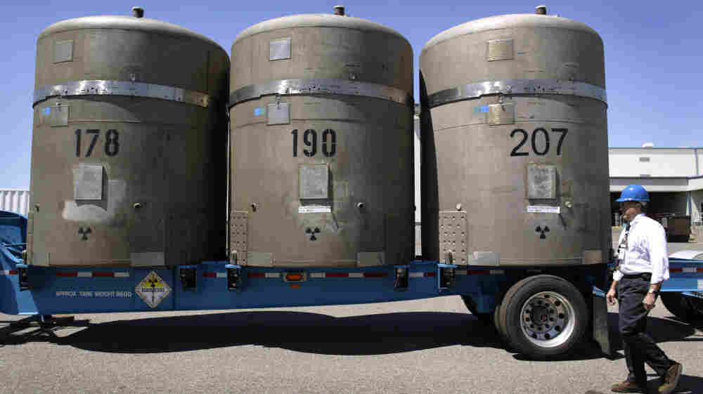 Without a centralized national repository for nuclear waste, the radioactive material is currently being kept at various sites across the country. Above, large concrete canisters, each holding 14 55-gallon drums of waste, are loaded on a truck in 2005 in Richland, Wash., where they were later shipped to a facility in New Mexico.