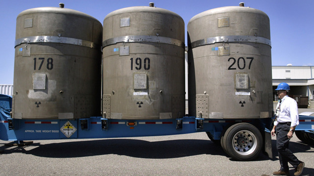 Without a centralized national repository for nuclear waste, the radioactive material is currently being kept at various sites across the country. Above, large concrete canisters, each holding 14 55-gallon drums of waste, are loaded on a truck in 2005 in Richland, Wash., where they were later shipped to a facility in New Mexico. (Getty Images)