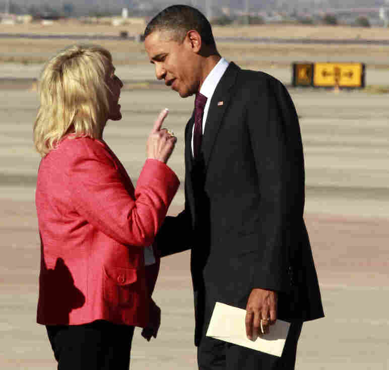 Arizona Gov. Jan Brewer points at President Barack Obama after he arrived at Phoenix-Mesa Gateway Airport on Wednesday.