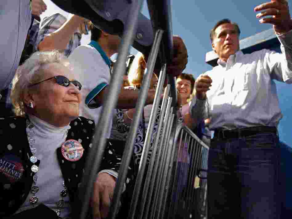 Former Massachusetts Gov. Mitt Romney greets supporters during a campaign event at Paramount Printing in Jacksonville, Fla., on Thursday.