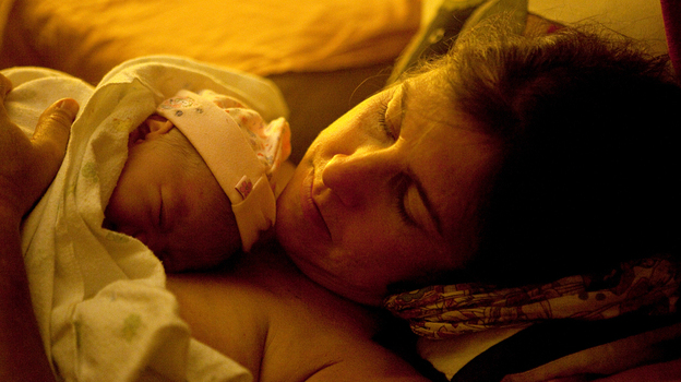 Shannon Earle holds her new baby Kiera Breen Earle, moments after she was born at their home last year. (NPR)