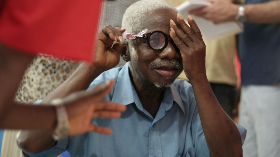 A man from Liberia uses a pump to adjust his liquid silicon lens. Liquid-lens glasses are part of an effort to make eyewear more accessible in the developing world. (Courtesy of Centre for Vision in the Developing World)