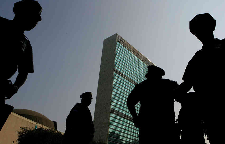 New York City Police officers stand guard in front of the United Nations buildings in 2005.