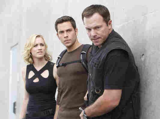 Yvonne Strahovski as Sarah Walker, Zachary Levi as Chuck Bartowski, and Adam Baldwin as John Casey in Chuck, which wraps tonight after five seasons.