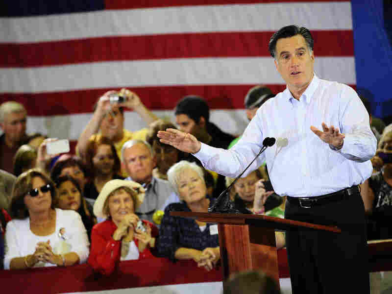 Mitt Romney speaks at Astrotech in Cape Canaveral, Fla., on Friday. He said he would make decisions about the space program the way he would make them in the private sector, by first researching and setting objectives.