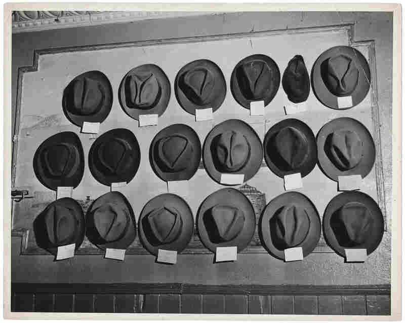 [Hats in a pool room, Mulberry Street, New York], circa 1943