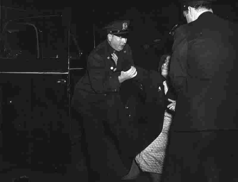 The dead man's wife arrived...and then she collapsed, circa 1940