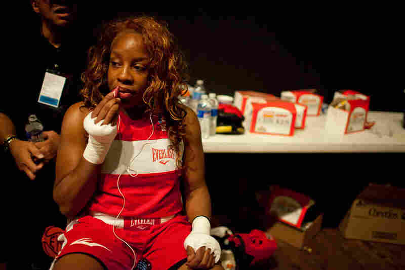 "Franchon Crews applies her lipstick backstage before her championship fight at the USA National Tournament in Colorado in June 2011. She won. ""I'm not doing it for the camera. I got my team, my city, but at the end of the day, it's me in there. It's me."""