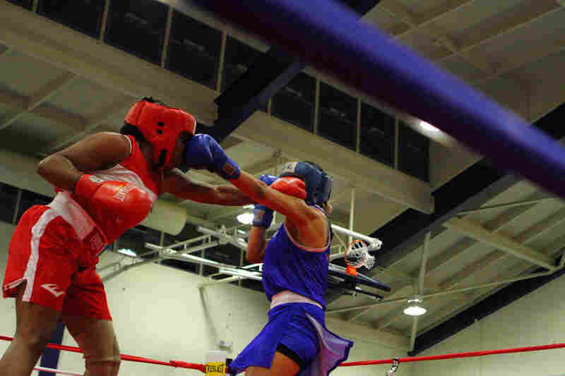 """Franchon, in red, trades punches at the International Duel in Oxnard, Calif., in November 2011. """"I'm a champion in life, so that's what gets me through."""""""