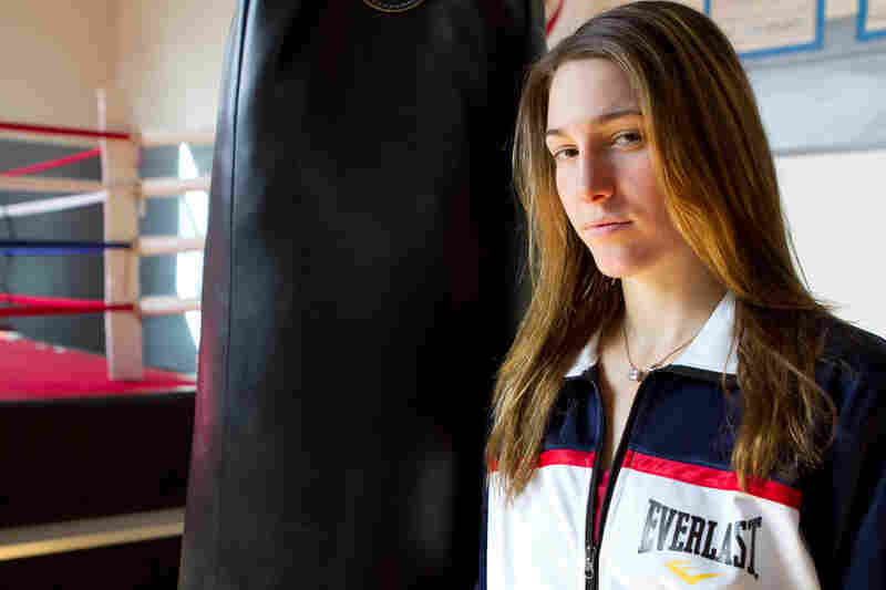 "Mikaela Mayer is one of eight women competing for the lightweight title. ""I like the fact that I'm feminine outside on the streets and I may not seem like a boxer, but really I am a boxer, and I have that side to me. I can be a woman and an aggressive athlete."""
