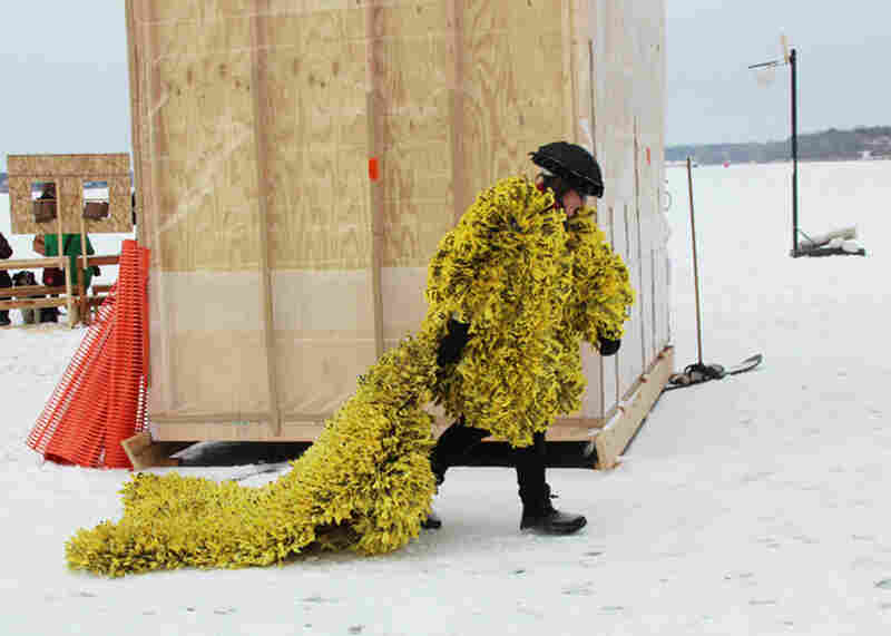 Most visitors to Art Shanty dress in the usual winter wear, but a few wear their own works of art, like a coat made of caution tape.