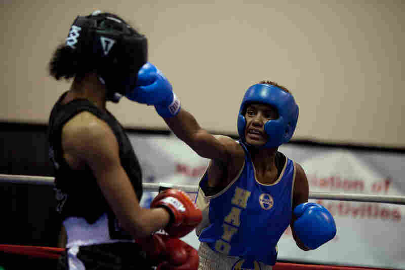 """Bertha fights N'yteeyah Sherman at the Police Athletic League Tournament in October 2011. """"You gotta think before you throw a punch. You can't be angry. When I'm in the ring, I'm thinking all the time, 'How can I beat this person and win?' I'm relaxed and I'm looking for my opponent's mistake. As soon as she makes a mistake, then I'll take advantage and get her."""""""