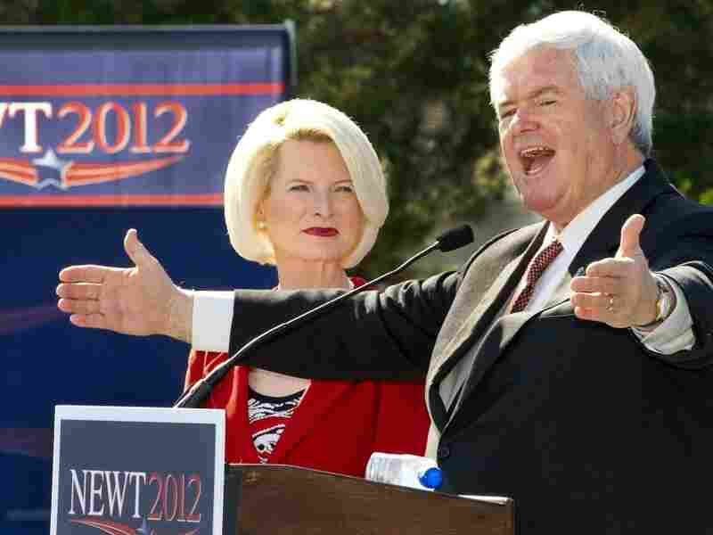 Republican presidential hopeful Newt Gingrich, with his wife, Callista, delivers remarks Sunday during a rally with senior citizens at The Villages retirement community in Lady Lake, Fla.