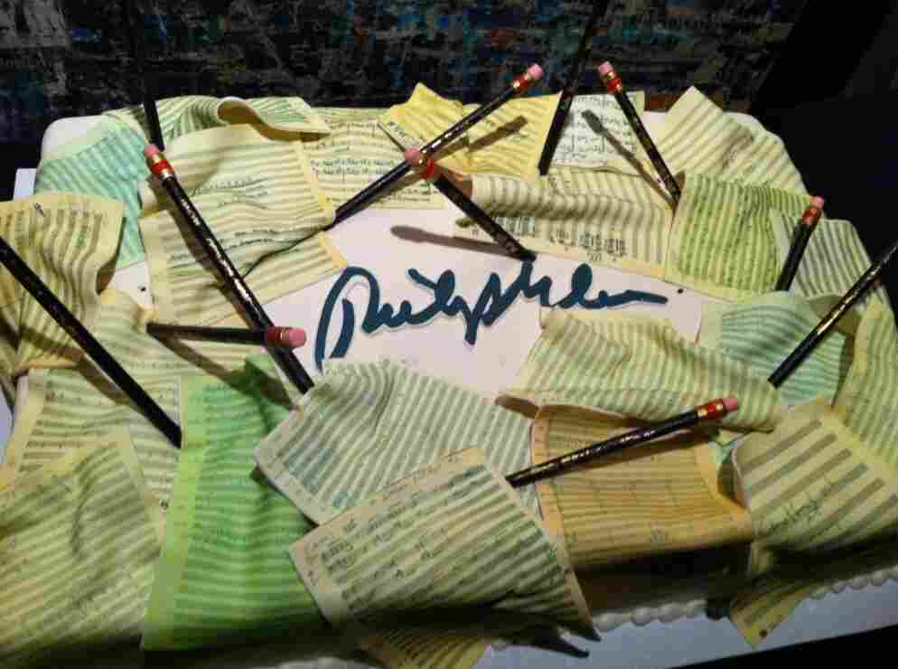 Philip Glass' 75th birthday cake — featuring some of his scores rendered in fondant.