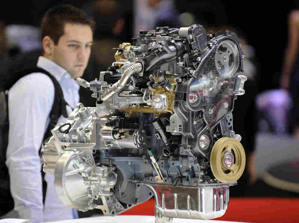 A visitor looks at a Citroen diesel engine at the Geneva Motor Show in Switzerland in 2010. Diesel is popular in Europe but not the U.S.; now, automakers are giving the technology more consideration as a means to meet new fuel economy standards.