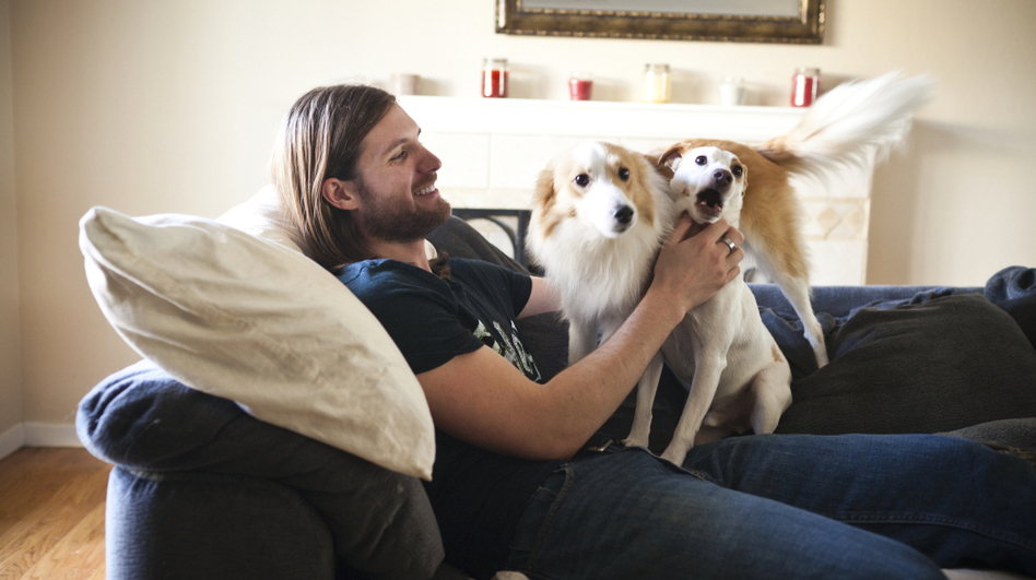 "Chris Stephens, 28, who has been battling depression all of his life, plays with his dogs at home in Concord, Calif., on Friday. After a dose of ketamine, Stephens says, ""I actually wanted to do things. I wanted to live life."" (Lianne Milton for NPR)"