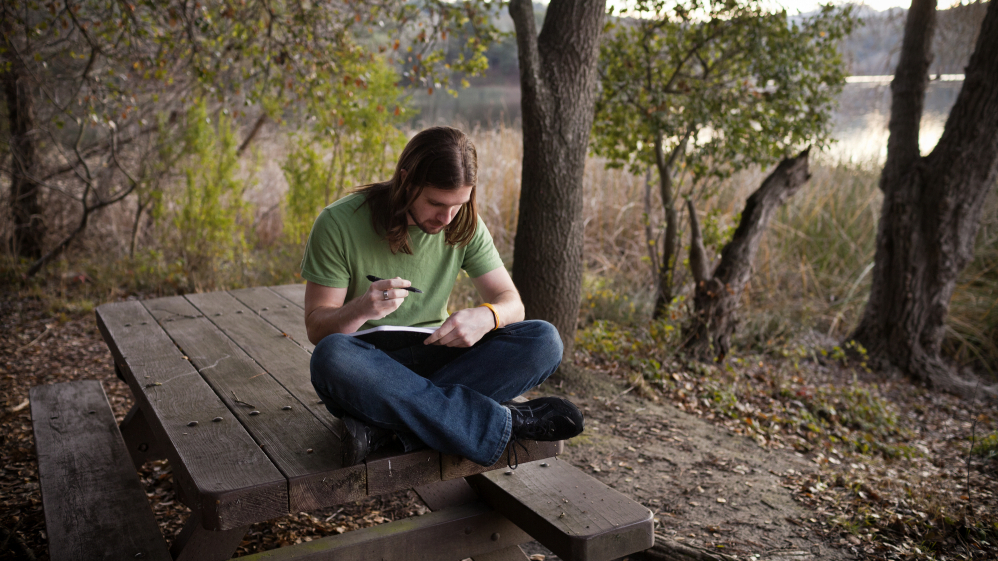 Chris Stephens, 28, who has battled depression all of his life, says he often spends time writing at Lafayette Reservoir Recreation Area in Lafayette, Calif.