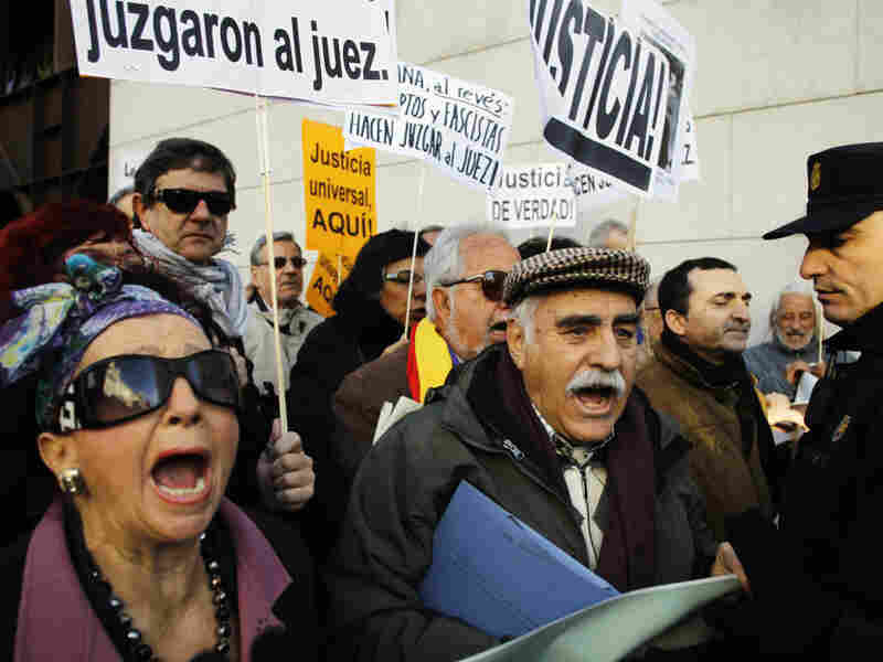 Garzon supporters gather during a demonstration outside the Supreme Court in Madrid, Jan. 24.
