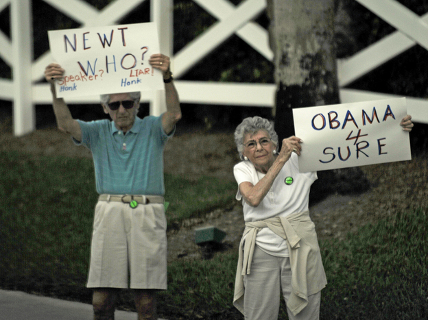 Two people protest Republican presidential hopeful Newt Gingrich outside a Republican Jewish Coalition rally Friday in Delray Beach, Fla.