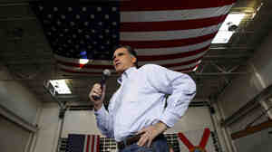 Former Massachusetts Gov. Mitt Romney campaigns at Ring Power Lift Trucks in Jacksonville, Fla., on Monday. Polls show him widening his lead in Florida after adopting a more aggressive campaign style.